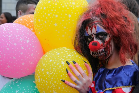 annual event: Sao Paulo, Brazil November 11 2015: An unidentified man in clown costumes in the annual event Zombie Walk in Sao Paulo Brazil.