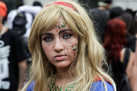 annual event: Sao Paulo, Brazil November 11 2015: An unidentified girl in Super Woman costumes in the annual event Zombie Walk in Sao Paulo Brazil.