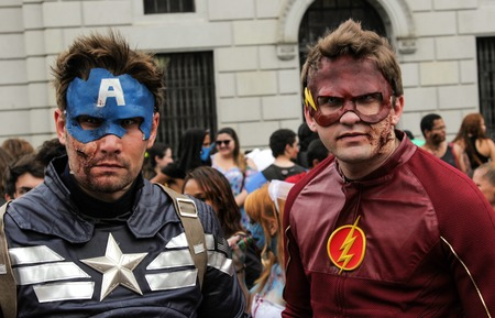 annual event: Sao Paulo, Brazil November 11 2015: Two unidentified men in super heroes costumes in the annual event Zombie Walk in Sao Paulo Brazil. Editorial