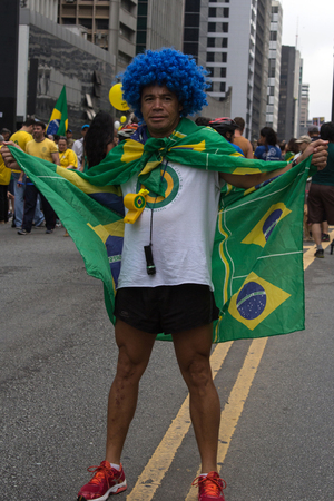 problematic: Sao Paulo Brazil March 13, 2016: One unidentified man in the biggest protest against federal government corruption in Sao Paulo.
