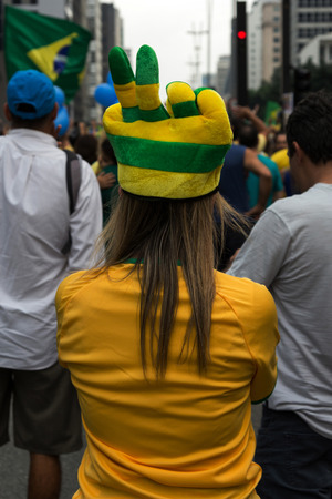 problematic: Sao Paulo Brazil March 13, 2016: One unidentified girl in the biggest protest against federal government corruption in Sao Paulo.