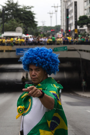 federal government: Sao Paulo Brazil March 13, 2016: One unidentified man in the biggest protest against federal government corruption in Sao Paulo.
