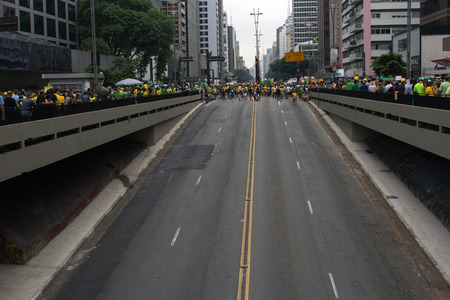problematic: Sao Paulo Brazil March 13, 2016: One unidentified girl in the biggest protest against federal government corruption in Sao Paulo. Protesters call for the impeachment of President Dilma Rousseff.