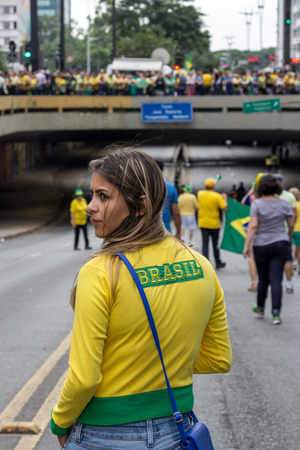 federal government: Sao Paulo Brazil March 13, 2016: One unidentified girl in the biggest protest against federal government corruption in Sao Paulo.