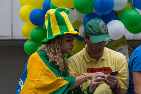 problematic: Sao Paulo Brazil March 13, 2016: One unidentified couple in the biggest protest against federal government corruption in Sao Paulo. Editorial