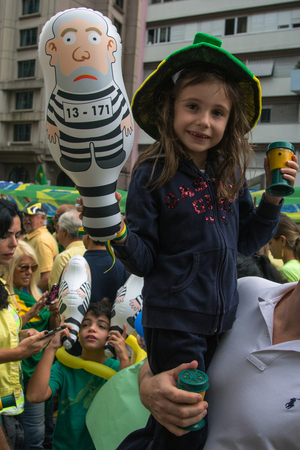 federal government: Sao Paulo Brazil March 13, 2016: One unidentified girl in the biggest protest against federal government corruption in Sao Paulo. Protesters call for the impeachment of President Dilma Rousseff.