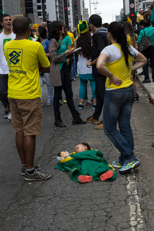 problematic: Sao Paulo Brazil March 13, 2016: One unidentified baby sleeping in the biggest protest against federal government corruption in Sao Paulo. Editorial