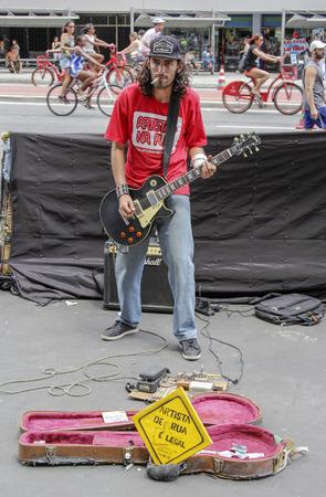 Sao Paulo, Brazil March 6, 2016: An unidentified street musician at Paulista Avenue playing guitar in Sao Paulo, Brazil.
