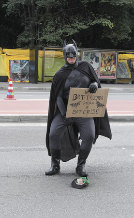 pauper: Sao Paulo, Brazil March 6, 2016: An unidentified man with superhero costume at Paulista Avenue asking for money in Sao Paulo, Brazil. Editorial