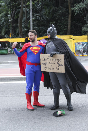 whimsy: Sao Paulo, Brazil March 6, 2016: Two unidentified men with superhero costume at Paulista Avenue asking for money in Sao Paulo, Brazil.