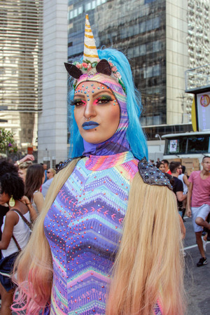 SAO PAULO, BRAZIL - June 18, 2017: An unidentified Drag Queen dressed in a costume celebrating lesbian, gay, bisexual, and culture in the 21st Gay Pride Parade Sao Paulo.