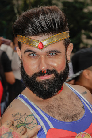 Sao Paulo, Brazil - June 3, 2018: An unidentified man celebrating the lesbian, gay, bisexual, and transgender culture in the 22th LGBTI Pride Parade Sao Paulo. Editorial