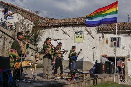 Machu Pichuu Pueblo, Peru - September 13, 2018: Unidentified group of musicians in typical peruvian clothes playing on the street for tourists in Cuzco Peru
