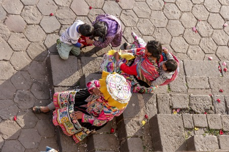 Machu Pichuu Pueblo, Peru - September 13, 2018: Women in typical clothes on the street asking for money to take picture with tourists Cuzco Peru Editorial