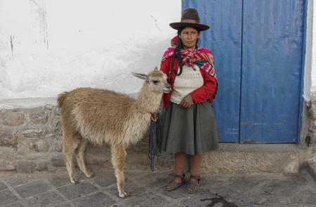 Machu Pichuu Pueblo, Peru - September 13, 2018: Unidentified woman in typical clothes on the street asking for money to take picture with tourists Cuzco Peru