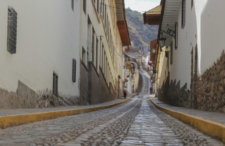 Close up of an ancient wall of the inca civilization in the city of Cuzco, Peru. Stones carved for a perfect assembly