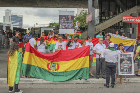 Sao Paulo, Brazil - February 17,2019: Unidentified group of people in a manifestation against the current government of Bolivia, with flags and cards.