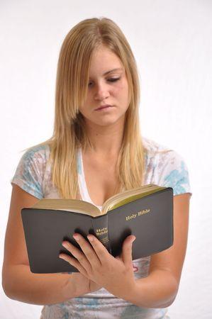 Girl reading the bible. 版權商用圖片