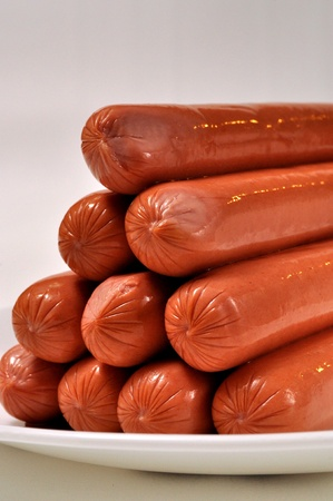 Hotdogs waiting for the grill. Stock Photo