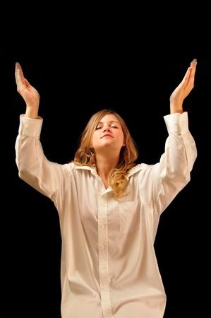 A young woman praising God
