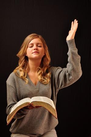 A pretty girl praising God