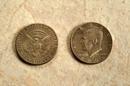The front and back view of a US fifty cent piece.