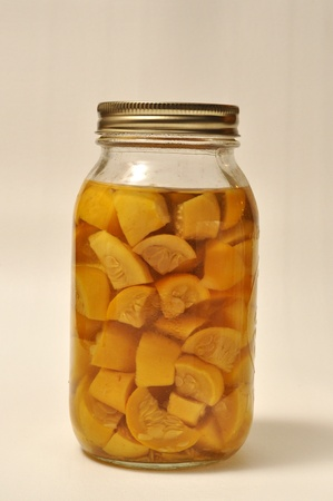 sita: A jar of home made canned squash sita on a white background. Stock Photo