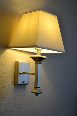 mounted: A wall mounted lamp gives off a soft yellow glow.