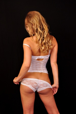 Rear view of a girl in white lingerie photo