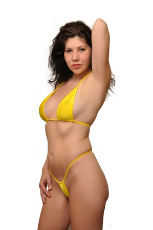 A attractive swimsuit modelis posing on a white background Stock Photo