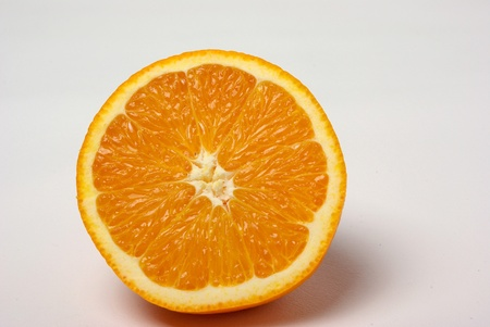 A half of a orange sits on a white background.