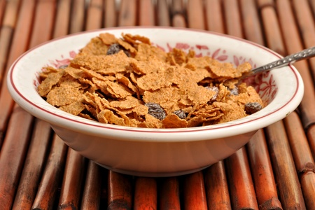 A bowel of bran flakes is mixed with raisins Stock Photo