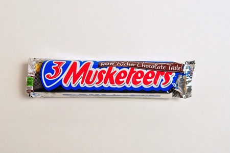 December 22, 2011. A 3 musketeers candy bar is on a white background. Stock Photo - 11652645