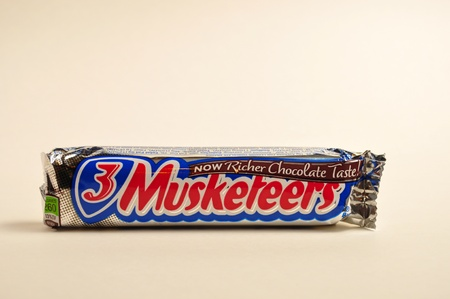 A 3 musketeers candy bar is on it's side on a white background. Stock Photo - 11652643