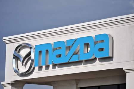 Mazda sign and logo are on a building on December 23 2011. Редакционное