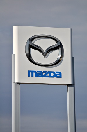 Mazda sign and logo outdoors display on December 23 2011. Editorial