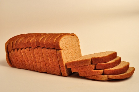 A loaf of wheat bread is sitting on a plain background