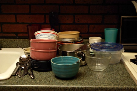 A pile of dirty dishes sit's on the counter top waiting to be washed Stock Photo - 12073418