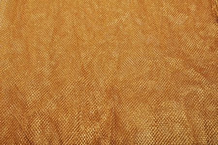 A image of a gold cloth usable asa background. Stock Photo - 12252397