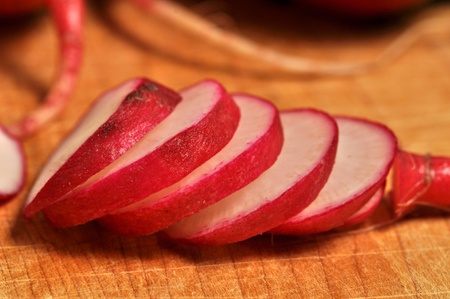 Sliced radish on a wooden cutting board. Stock Photo - 12253535