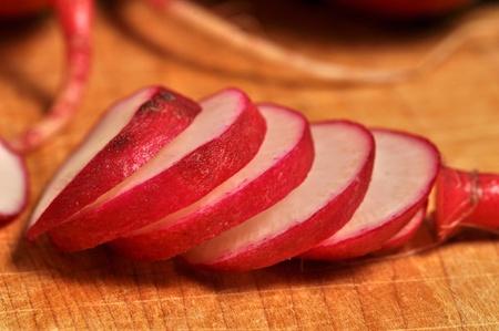 Sliced radish on a wooden cutting board. Stock Photo - 12253535