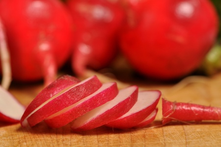 A sliced radish laying on a wooden cutting board. Stock Photo - 12247149