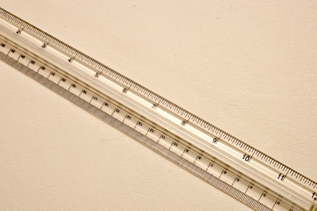 A clear plastic ruler is on a white background. Reklamní fotografie