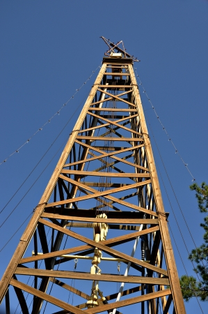 A old oil derreck sits restored in the area around the East Texas Oil Musum in Kilgore Texas  photo