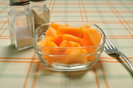 Cut and prepared cantaloupe is ready to eat on the table