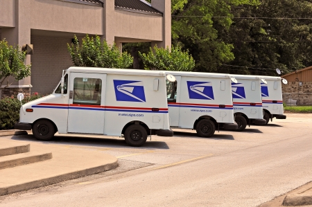 June 8 2013, a small fleet of United States Postal Service Trucks are parked outside a Post Office in Flint Texas.