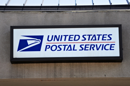 united states postal service: June 8 2013. A image of a wall mounted United States Postal Service sign