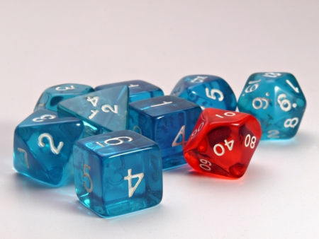roleplaying: A old used set of dice used in  roleplaying games.