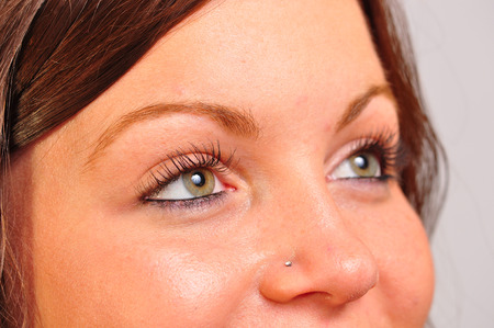 A closeup image of a pretty womans eyes looking to the side of the camera.