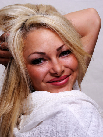 blond haired: A attractive blond haired woman is smiling big.